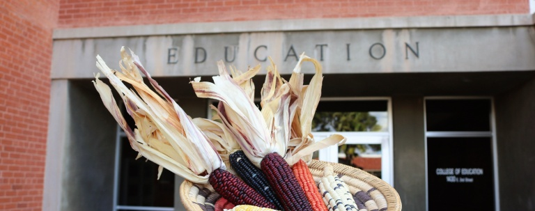 A basket of corn with the Education building in the background